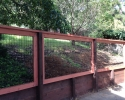 Pressure Treated retaining wall with Black PVC coated welded wire picture frame fence and Redwood